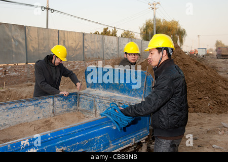 Construction workers at work - Stock Photo