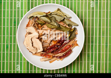 Dried spices used for Tom Yum soup, a hot and sour soup commonly found in Thailand - Stock Photo