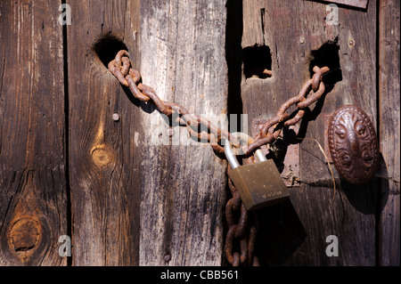 Stock photo of a padlocked and chained gate. - Stock Photo