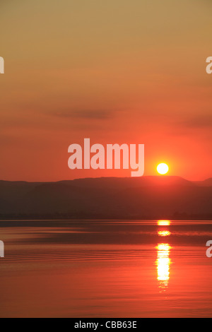 Israel, sunset over the Sea of Galilee - Stock Photo