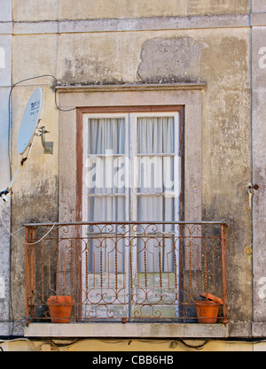 Satellite Dish on an Old Weathered Balcony in the Medieval Village of Sintra - Stock Photo