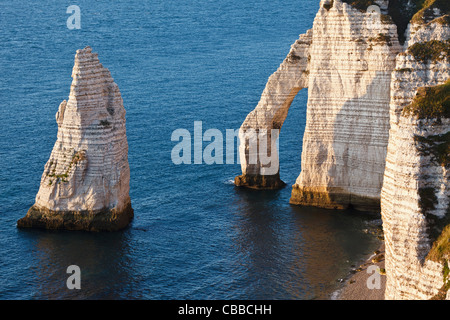 L'Aiguille (the Needle) and Porte d'Aval at Etretat, Normandy, France - Stock Photo