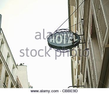 Hotel sign on city street - Stock Photo