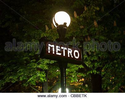 Metro sign on streetlight in Paris - Stock Photo