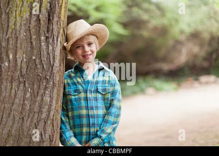 Boy wearing cowboy hat outdoors - Stock Photo