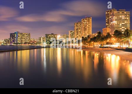 Sunset at famous Waikiki Beach, Honolulu, Oahu, Hawaii - Stock Photo