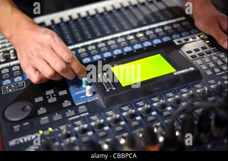 Technician using a sound mixer - Stock Photo