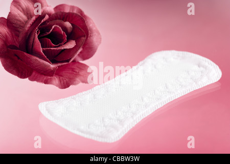 Panty Liner with Rose on Pink Background - Stock Photo