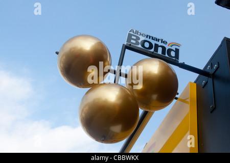 Three brass balls Traditional symbol of pawnbroker / pawn shop Albemarle Bond chain Albany Road Roath Cardiff Wales - Stock Photo