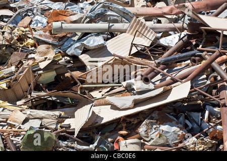 Pile of scrap metal in junkyard, full frame - Stock Photo