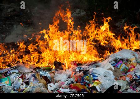 Burning household waste in the indian countryside - Stock Photo