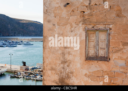 Window in old building at harbor - Stock Photo