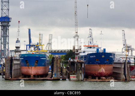 Two ships in dry dock in a shipyard in Rotterdam, The Netherlands - Stock Photo