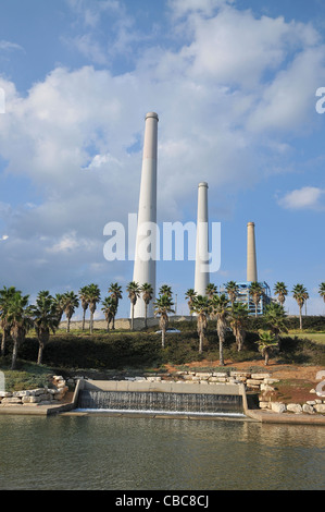 Israel, Hadera, The Hadera River and park the coal operated power plant's flues in the background - Stock Photo
