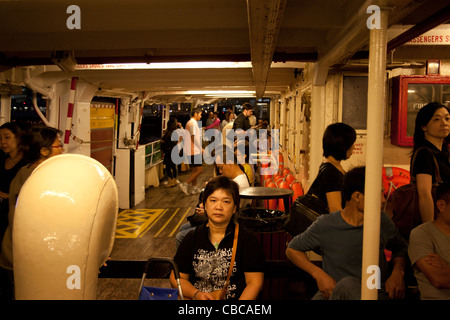 Passengers on the lower deck of the Star Ferry Hong Kong Island, SAR China - Stock Photo