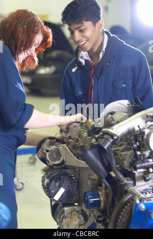 Students working on car engine - Stock Photo