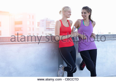 Runners talking on rooftop - Stock Photo