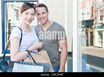 Couple carrying shopping bags - Stock Photo