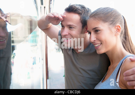 Couple window shopping together - Stock Photo
