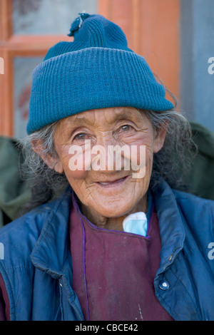Old Ladakhi woman in traditional dress at Lamayuru, (Ladakh) Jammu & Kashmir, India - Stock Photo