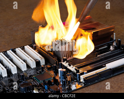 dashing flame from a welding rorch while burning a main board wich is located in rusty ambiance - Stock Photo