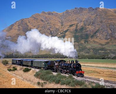 The Kingston Flyer - Historic Steam Train seen leaving Fairlight, Kingston, South Island, New Zealand. - Stock Photo