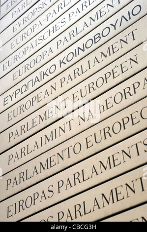 Detail of the entrance of the European Parliament in Brussels Belgium written in all the european languages. - Stock Photo