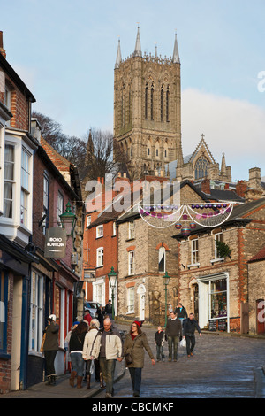 View up narrow cobbled street leading to uphill area with the cathedral. Steep Hill, Lincoln, Lincolnshire, England, - Stock Photo