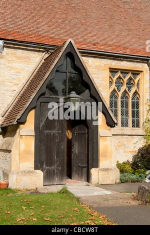 St. John the Baptist Church entrance, Aston Cantlow, Warwickshire, England, UK - Stock Photo