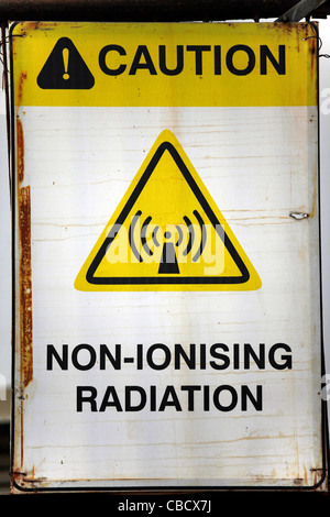 caution threat non-ionising radiation health-risk notification placard - Stock Photo