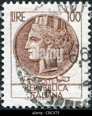 ITALY - CIRCA 1959: A stamp printed in Italy, is shown Italia Turrita after Syracusean Coin, circa 1959 - Stock Photo