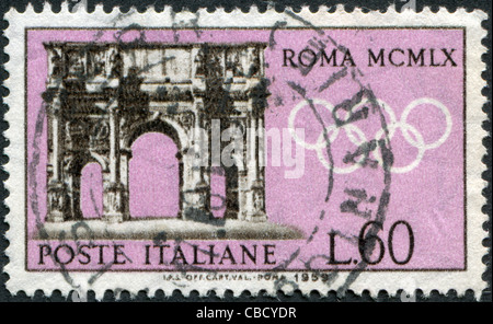 ITALY - CIRCA 1959: A stamp printed in Italy, is dedicated to Olympic Games in Rome, shows the Arch of Constantine, - Stock Photo