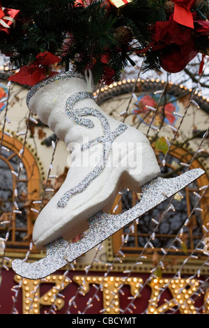 Giant Ice Skate Christmas decorations in the city of London England - Stock Photo