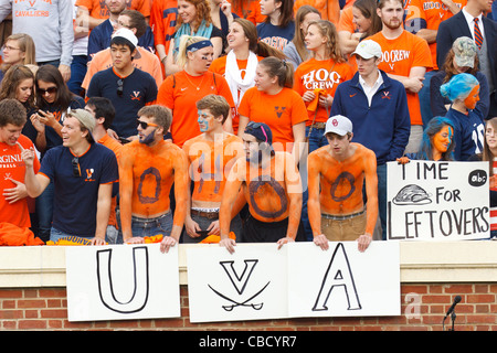 University of Virginia students in the stands before the game against the Virginia Tech Hokies at Scott Stadium, - Stock Photo