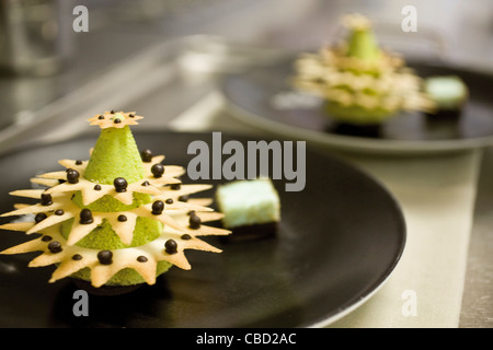 Gourmet dessert shaped like Christmas tree - Stock Photo