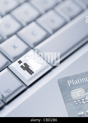 Detail of a laptop keyboard with a bride and groom symbol on one key and a credit card at the bottom right corner - Stock Photo