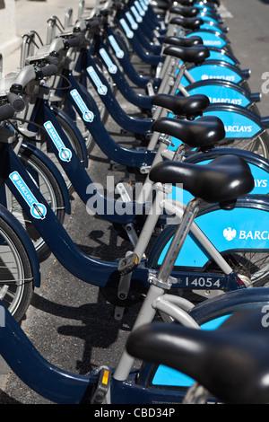 Row of Barclays Boris Bikes London England - Stock Photo