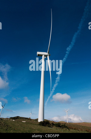 Wind turbines against blue sky - Stock Photo