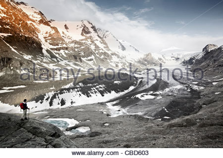 Woman overlooking glacial landscape - Stock Photo