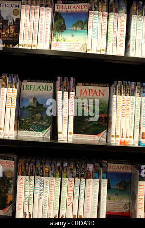 Travel guidebooks for sale in bookshop. - Stock Photo