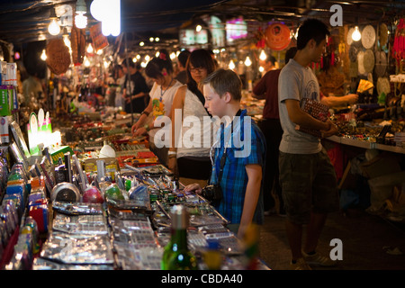 Young Boy shopping at Temple Street Night Market - Stock Photo