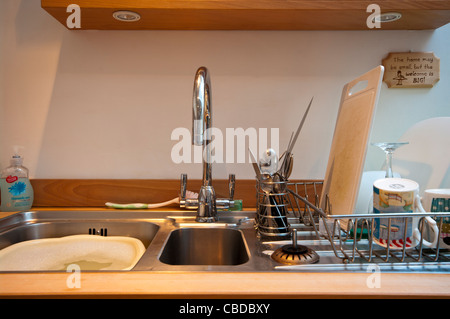 Kitchen Sink And Draining Board With Washing Up   Stock Photo