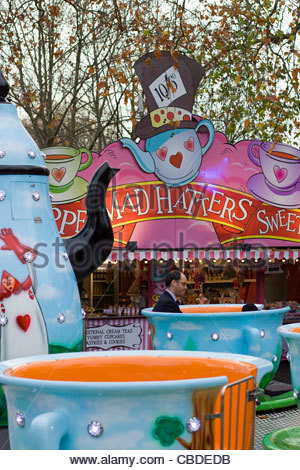 The Mad Hatters tea Party ride at the Fairground Christmas Market in Hyde Park London England - Stock Photo
