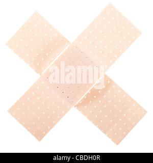 Band aid bandage in cross shape - Stock Photo
