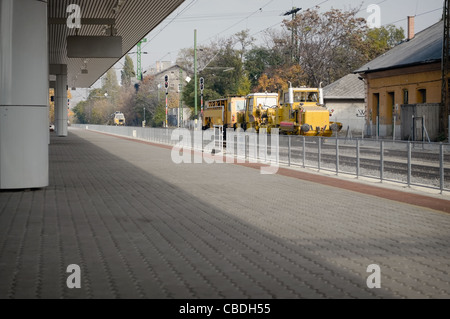Railway maintenance machine at a railway station - Stock Photo