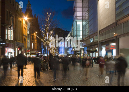 Christmas Shoppers Shopping buying presents  near The Arndale Centre on Market Street Manchester City Centre UK - Stock Photo