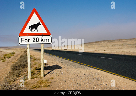 Warning sign for brown hyenas on highway, Namibia - Stock Photo