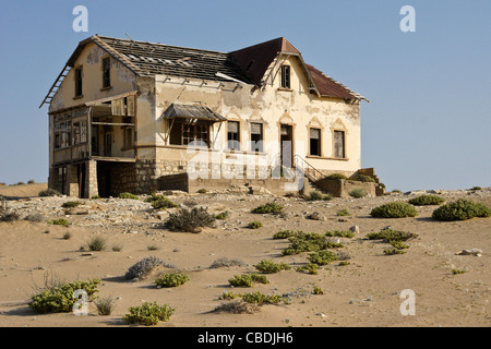 House in abandoned diamond mining town of Kolmanskop, Namibia - Stock Photo