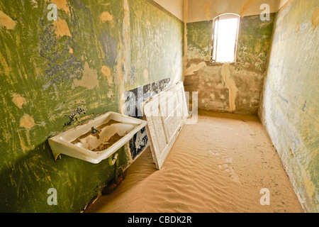 Old house in abandoned diamond mining town of Kolmanskop, Namibia - Stock Photo