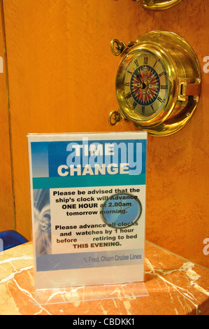 Time change notice at reception, Fred Olsen M.S.Balmoral cruise ship in North Sea, Northern Europe - Stock Photo